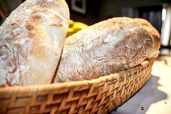 Ciabatta bread in a basket | BakingGlory.com