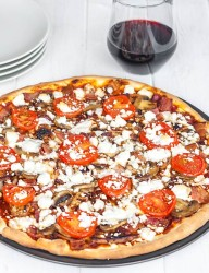 Home-made pizza from scratch with a perfect combination of grilled chicken and feta cheese.