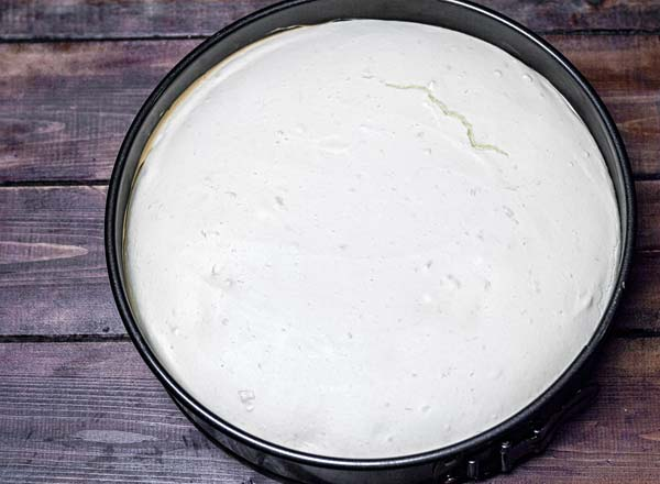 Baked cheesecake batter still in the pan