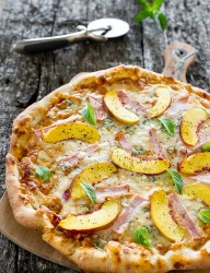 A delicious combination of peaches and Canadian back bacon on a pizza flatbread